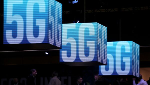 Hanging cubes display 5G logos at the Mobile World Congress in Barcelona, Spain, February 26, 2019. REUTERS/Sergio Perez/File Photo - Sputnik International