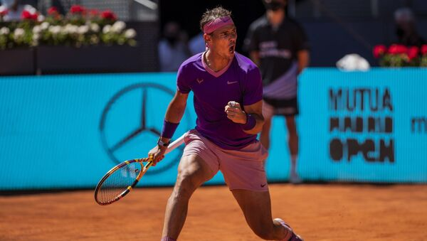 Spain's Rafael Nadal celebrates a point against Germany's Alexander Zverev during their match at the Mutua Madrid Open tennis tournament in Madrid, Spain, Friday, May 7, 2021 - Sputnik International