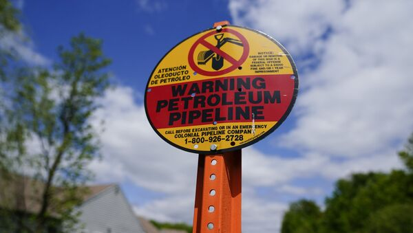 A warning sign is posted along the path of the Colonial Pipeline in Garnet Valley, Pa., Monday, May 10, 2021. Gasoline futures are ticking higher following a cyberextortion attempt on the Colonial Pipeline, a vital U.S. pipeline that carries fuel from the Gulf Coast to the Northeast. - Sputnik International