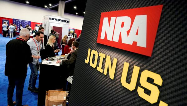 Attendees sign up at the National Rifle Association (NRA) booth at the Conservative Political Action Conference (CPAC) annual meeting at National Harbor in Oxon Hill, Maryland, U.S., February 27, 2020. - Sputnik International