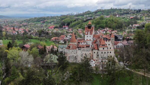 Bran Castle towers above Bran commune, in Brasov county, Romania, May 8, 2021. Picture taken with a drone.  - Sputnik International