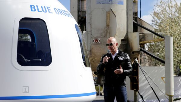 Amazon and Blue Origin founder Jeff Bezos addresses the media about the New Shepard rocket booster and Crew Capsule mockup at the 33rd Space Symposium in Colorado Springs, Colorado, United States April 5, 2017 - Sputnik International
