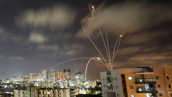 Streaks of light are seen as Israel's Iron Dome anti-missile system intercepts rockets launched from the Gaza Strip towards Israel, as seen from Ashkelon, Israel May 12, 2021. - Sputnik International