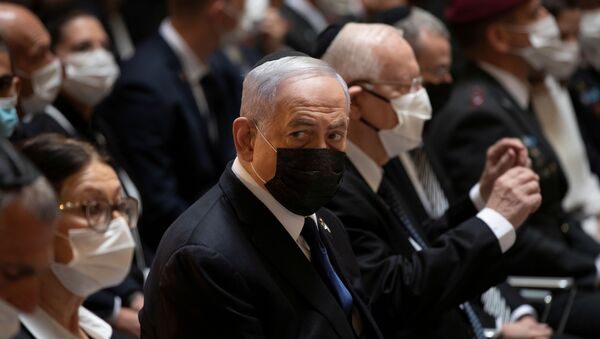 Israeli Prime Minister Benjamin Netanyahu attends an official ceremony marking Israel's Memorial Day, which commemorates Israel's fallen soldiers and Israeli victims of hostile attacks, at Mount Herzl military cemetery in Jerusalem April 14, 2021. - Sputnik International