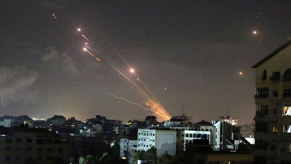 Rockets are launched by Palestinian militants into Israel, in Gaza May 12, 2021. - Sputnik International