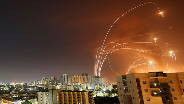 Streaks of light are seen as Israel's Iron Dome anti-missile system intercept rockets launched from the Gaza Strip towards Israel, as seen from Ashkelon, Israel, 12 May 2021. - Sputnik International