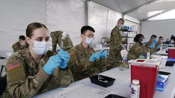 In this 9 March 2021, file photo, Army health specialists fill syringes with the Pfizer COVID-19 vaccine in Miami. - Sputnik International