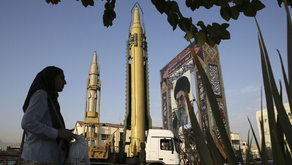 In this 24 September 2017 file photo, surface-to-surface missiles and a portrait of the Iranian Supreme Leader Ayatollah Ali Khamenei are displayed by the Revolutionary Guard in an exhibition marking the anniversary of outset of the 1980s Iran-Iraq war, at Baharestan Square in Tehran, Iran. - Sputnik International