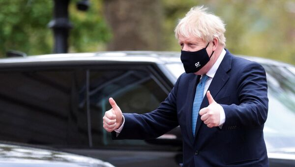 Britain's Prime Minister Boris Johnson makes a 'thumbs-up' gesture as he arrives at the G7 foreign ministers meeting in London on May 5, 2021 - Sputnik International