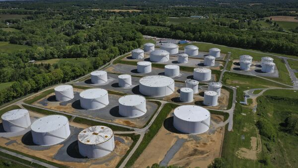 In an aerial view, fuel holding tanks are seen at Colonial Pipeline's Dorsey Junction Station on May 13, 2021 in Washington, DC. The Colonial Pipeline has returned to operations following a cyberattack that disrupted gas supply for the eastern U.S. for days.  - Sputnik International