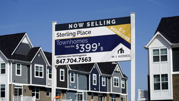 An advertising sign for building land stands in front of a new home construction site in Northbrook, Ill., Sunday, March 21, 2021. - Sputnik International