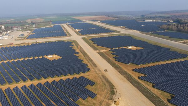 This aerial picture taken on April 20, 2021, shows a photovoltaic power station on the former Marville-Montmedy airbase in Marville, eastern France, on April 20, 2021 - Sputnik International