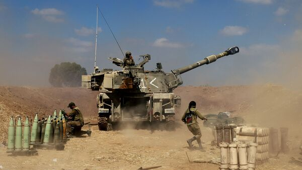 Israeli soldiers fire a 155mm self-propelled howitzer towards the Gaza Strip from their position near the southern Israeli city of Sderot on 13 May 2021. Israel faces an escalating conflict on two fronts, scrambling to quell riots between Arabs and Jews on its own streets after days of exchanging deadly fire with Palestinian militants in Gaza. - Sputnik International