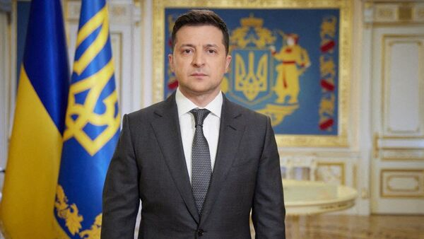 This handout photograph taken and released by The Ukrainian Presidential Press Service on April 20, 2021, shows Ukranian President Volodymyr Zelensky speaking during his late evening address in Kiev.  - Sputnik International
