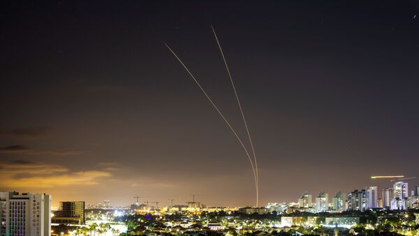 Streaks of light are seen as Israel's Iron Dome anti-missile system aims to intercept rockets launched from the Gaza Strip towards Israel, as seen from Ashkelon, Israel May 14, 2021. - Sputnik International