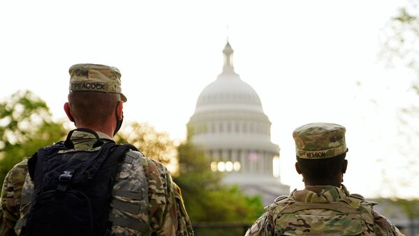 Members of the National Guard patrol the U.S. Capitol grounds prior to U.S. President Joe Biden's first address to a joint session of the U.S. Congress in Washington, U.S., April 28, 2021. - Sputnik International
