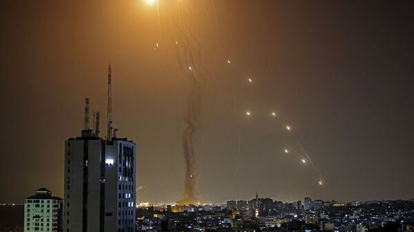 A rocket launched from Gaza city controlled by the Palestinian Hamas movement, is intercepted by Israel's Iron Dome aerial defence system, on May 11, 2021. - Sputnik International