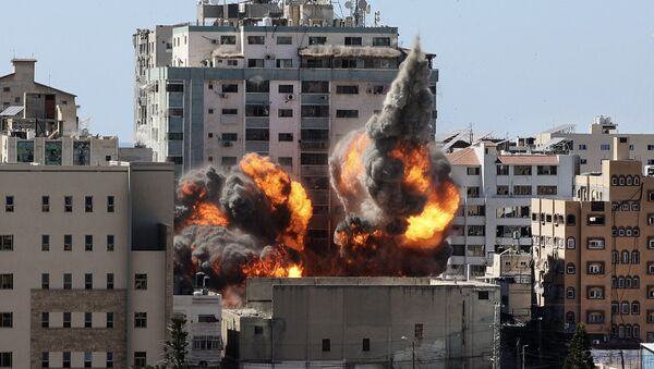 A ball of fire erupts from the Jala Tower as it is destroyed in an Israeli airstrike in Gaza city controlled by the Palestinian Hamas movement, on 15 May 2021. - Sputnik International