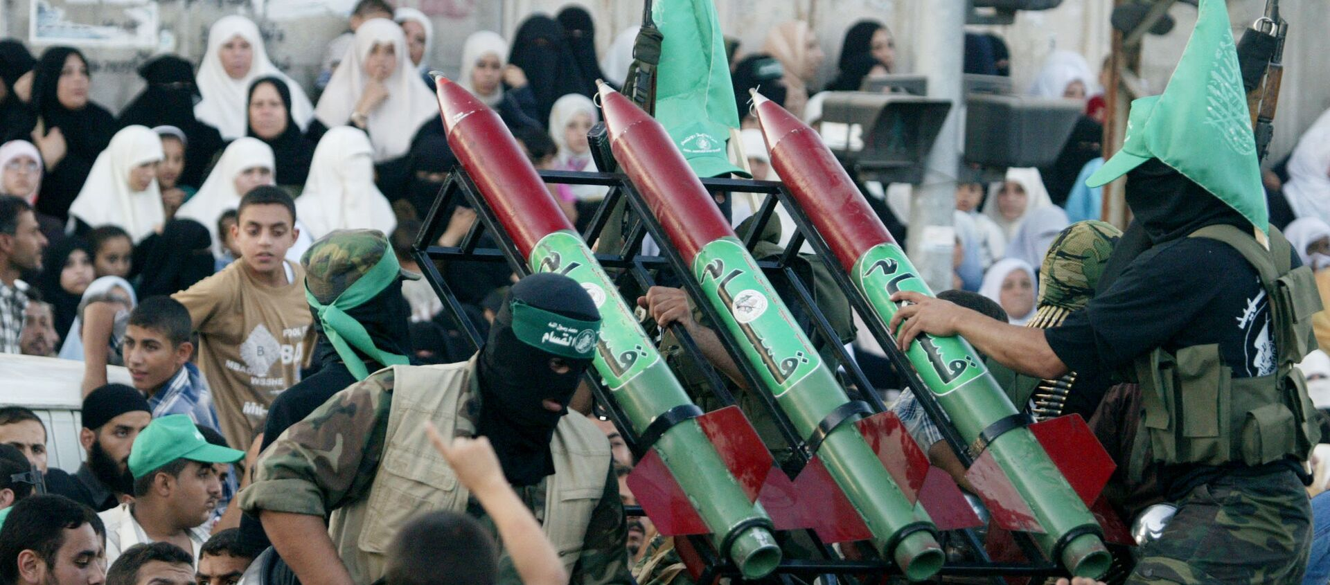 Masked Palestinian Hamas militants display their weapons during a parade in Gaza City. File photo. - Sputnik International, 1920, 15.05.2021