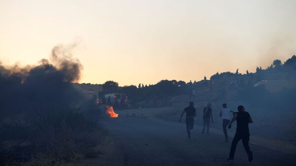 Palestinian demonstrators run towards an ambulance during a protest over tension in Jerusalem and Israel-Gaza escalation, near Tubas in the Israeli-occupied West Bank, May 15, 2021. - Sputnik International