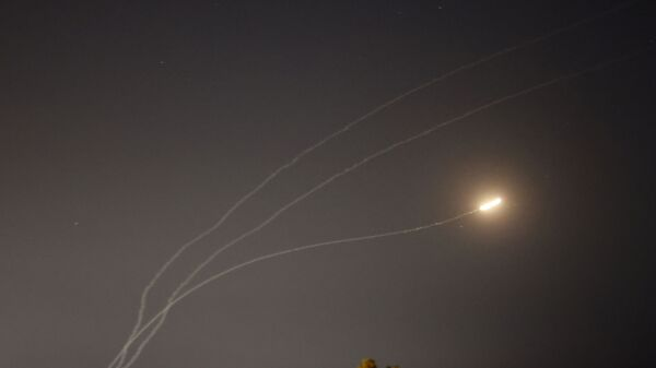 This picture taken from the southern Israeli city of Sderot shows rockets fired from the Gaza Strip being intercepted by the Israeli Iron Dome missile defence system, on May 16, 2021. - Sputnik International