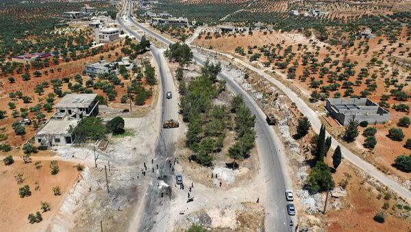 An aerial picture shows the site of an improvised explosive device which hit a joint Turkish-Russian patrol on the strategic M4 highway, near the Syrian town of Ariha in the rebel-held northwestern Idlib province, on July 14, 2020.  - Sputnik International