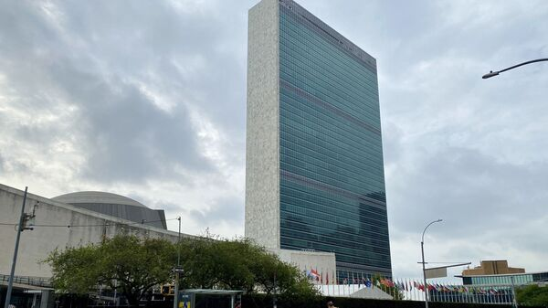 People walk on an empty First Avenue near the United Nations headquarters in New York on September 9, 2020. - Sputnik International