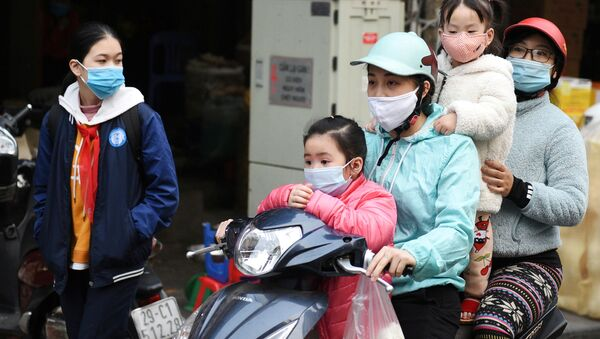 FILE PHOTO: A family wears protective masks as they ride a motorbike in the street amid the coronavirus disease (COVID-19) outbreak in Hanoi, Vietnam, January 29, 2021 - Sputnik International