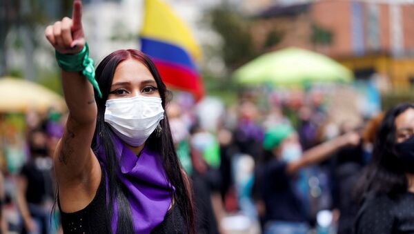 A woman gestures during a protest against sexual assault by the police and the excess of public force against peaceful protests, in Bogota, Colombia, May 15, 2021. - Sputnik International