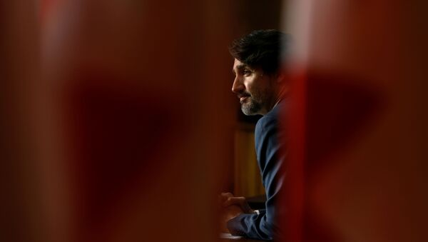 Canada's Prime Minister Justin Trudeau attends a news conference, as efforts continue to help slow the spread of the coronavirus disease (COVID-19), in Ottawa, Ontario, Canada May 18, 2021 - Sputnik International