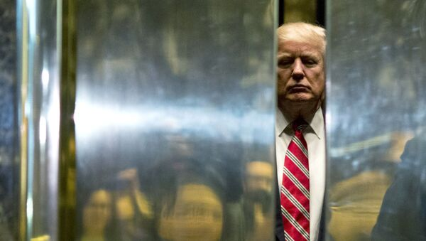 In this file photo taken on January 16, 2017 US President-elect Donald Trump boards the elevator after escorting Martin Luther King III to the lobby after meetings at Trump Tower in New York City. - The Trump Organization is being investigated in a criminal capacity as New York prosecutors advance their probe into former president Donald Trump's business dealings, the state attorney general announced Tuesday. We have informed the Trump Organization that our investigation into the organization is no longer purely civil in nature, a spokesman for Attorney General Letitia James' office said. We are now actively investigating the Trump Organization in a criminal capacity, along with the Manhattan DA. - Sputnik International