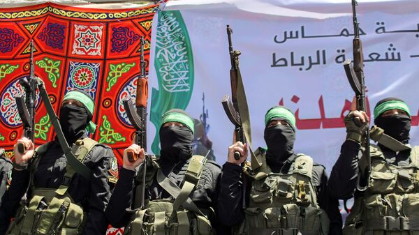 Palestinian Hamas militants take part in a protest over the possible eviction of several Palestinian families from homes on land claimed by Jewish settlers in the Jerusalem's Sheikh Jarrah neighbourhood, in the northern Gaza Strip May 7, 2021 - Sputnik International