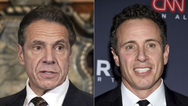 """New York Gov. Andrew M. Cuomo appears during a news conference about the COVID-19at the State Capitol in Albany, N.Y., on Dec. 3, 2020, left, and CNN anchor Chris Cuomo attends the 12th annual CNN Heroes: An All-Star Tribute at the American Museum of Natural History in New York on Dec. 9, 2018. CNN said Thursday, May 20, 2021 it was """"inappropriate"""" for anchor Chris Cuomo to have been involved in phone calls with the staff of his brother, New York Gov. Andrew Cuomo, where strategies on how the governor should respond to sexual harassment allegations were allegedly discussed. - Sputnik International"""