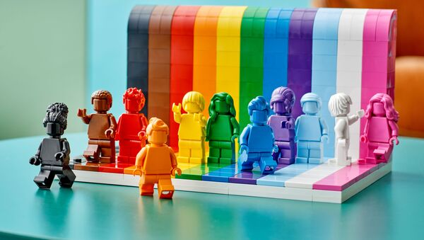 Figures developed from the colors of the rainbow flag are seen in a photograph released May 20, 2021 for the launch of the new LEGO Everyone is Awesome set. - Sputnik International