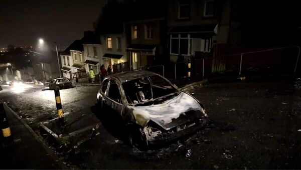 Gangs of young people have set cars on fire and rolled them down a hill in Swansea, Wales UK - Sputnik International
