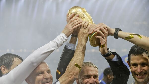 France head coach Didier Deschamps holds the World Cup after defeating Croatia in the 2018 final in Moscow. - Sputnik International