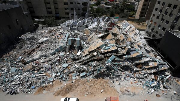 A view shows the remains of a tower building destroyed by Israeli missile strikes in the recent cross-border violence between Palestinian militants and Israel, following Israel-Hamas truce, in Gaza City May 21, 2021 - Sputnik International