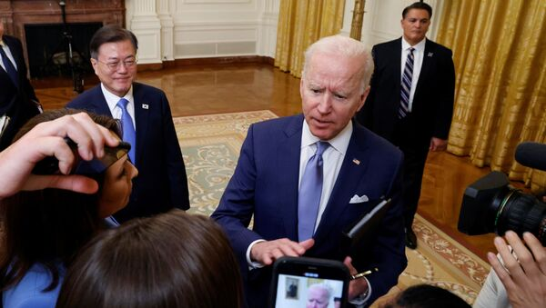 South Korea's President Moon Jae-in smiles as U.S. President Joe Biden interacts with members of the media after a joint news conference after a day of meetings at the White House, in Washington, U.S. May 21, 2021. - Sputnik International