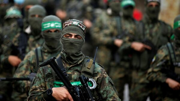 Palestinian Hamas militants take part in an anti-Israel rally in Gaza City May 22, 2021. REUTERS/Mohammed Salem - Sputnik International