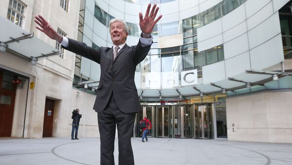Tony Hall poses for photographers on his arrival at Broadcasting House for his first day as the new Director General of the BBC, in central London April 2, 2013. - Sputnik International