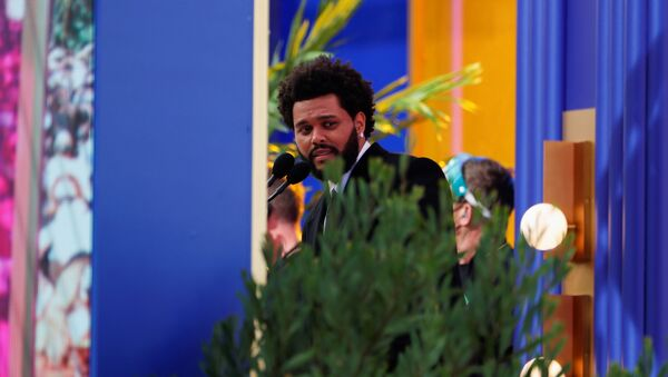 The Weeknd speaks after he won the award for Top Hot 100 Artist at the 2021 Billboard Music Awards outside the Microsoft Theater in Los Angeles, California, U.S. May 23, 2021 - Sputnik International
