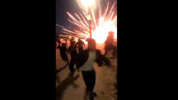 Screenshot from a video allegedly filmed at a massive viral party dubbed Adrian's Kickback in Huntington Beach, California - Sputnik International
