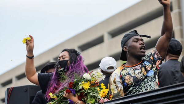 Tony B reacts while rapping from a truck as people march during the One Year, What's Changed? rally hosted by the George Floyd Global Memorial to commemorate the first anniversary of his death, in Minneapolis, Minnesota, U.S. May 23, 2021 - Sputnik International