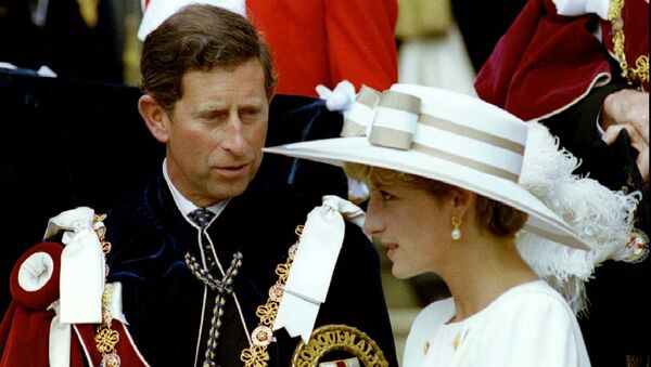 Prince Charles looks towards Princess Diana as they await their carriage to depart the Order of the Garter ceremony at Windsor Castle June 15, 1992 - Sputnik International