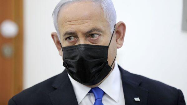 Israeli Prime Minister Benjamin Netanyahu attends a hearing evidence stage for his trial over alleged corruption crimes, at the Jerusalem district court, in Salah El-Din, East Jerusalem, Monday, April 5, 2021 - Sputnik International