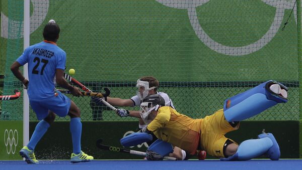 Germany's goalkeeper Nicolas Jacobi, center, looks for the ball enter his goal which scored by Indian player India's Rupinder Pal Singh during a men's field hockey match (File) - Sputnik International
