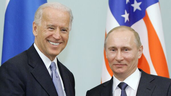 In this March 10, 2011 file photo, then Vice President  Joe Biden, left, shakes hands with Russian Prime Minister Vladimir Putin in Moscow, Russia. - Sputnik International