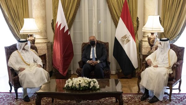Qatar's Deputy Prime Minister and Foreign Minister Sheikh Mohammed bin Abdulrahman bin Jassim Al-Thani, left, meets with Egyptian Foreign Minister Sameh Shoukry, center, at the Tahrir Palace in Cairo, Egypt, Tuesday, May 25, 2021 - Sputnik International
