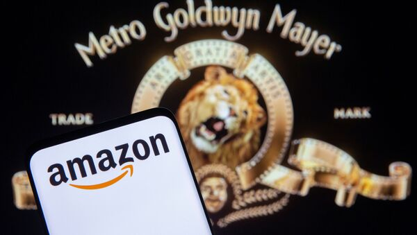 Smartphone with Amazon logo is seen in front of displayed MGM logo in this illustration taken, May 26, 2021 - Sputnik International