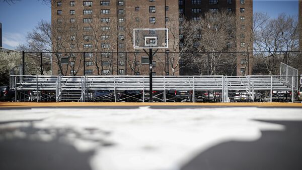Basketball backboards stand without hoops after city officials had them removed to reduce gatherings at Holcombe Rucker Park, Thursday, March 26, 2020, in New York. Across the U.S., police departments are taking a lead role in enforcing social distancing rules that health officials say are critical to containing the coronavirus. In New York City, they've started dismantling basketball hoops to prevent people from gathering in parks and playing.  - Sputnik International